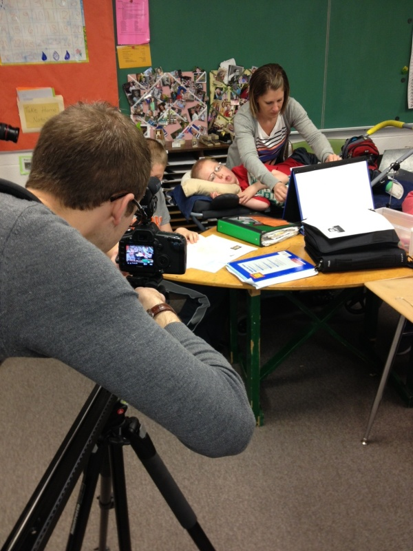 James Kessel filming Isaac at school